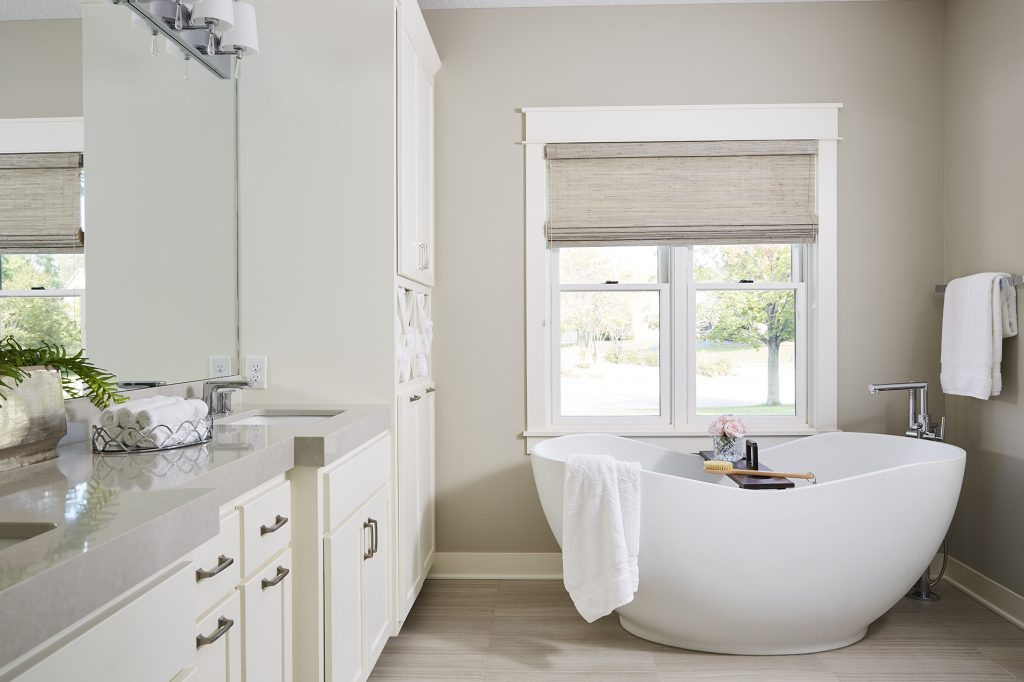 A soaking tub made this master bath a retreat for our clients and simultaneously opened up floor space to allow for a visually lighter design.