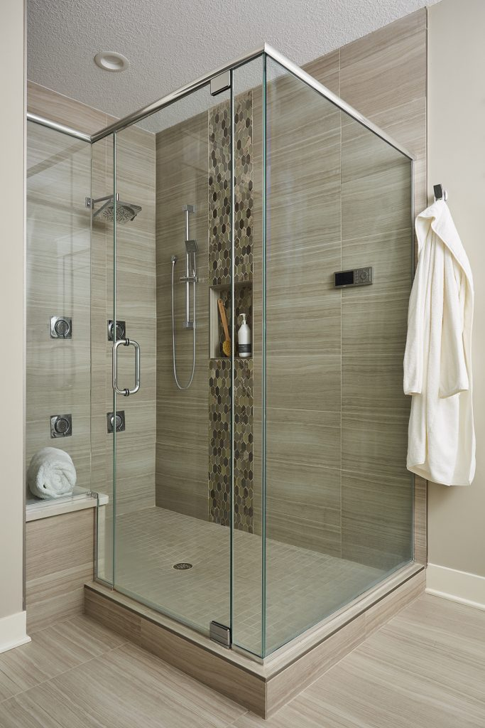 A built-in bench and sleek glass door and walls made this walk-in shower a dream come true.