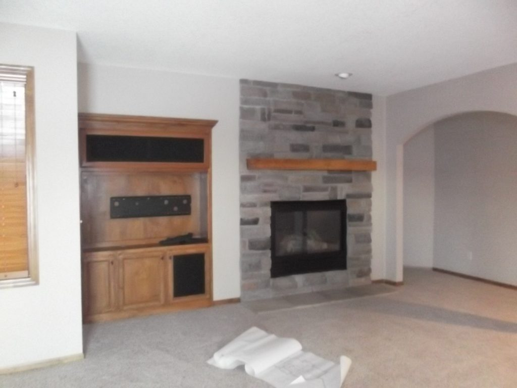 With the fireplace off to the right, it limited the furniture arrangement possibilities and left the room visually unbalanced.