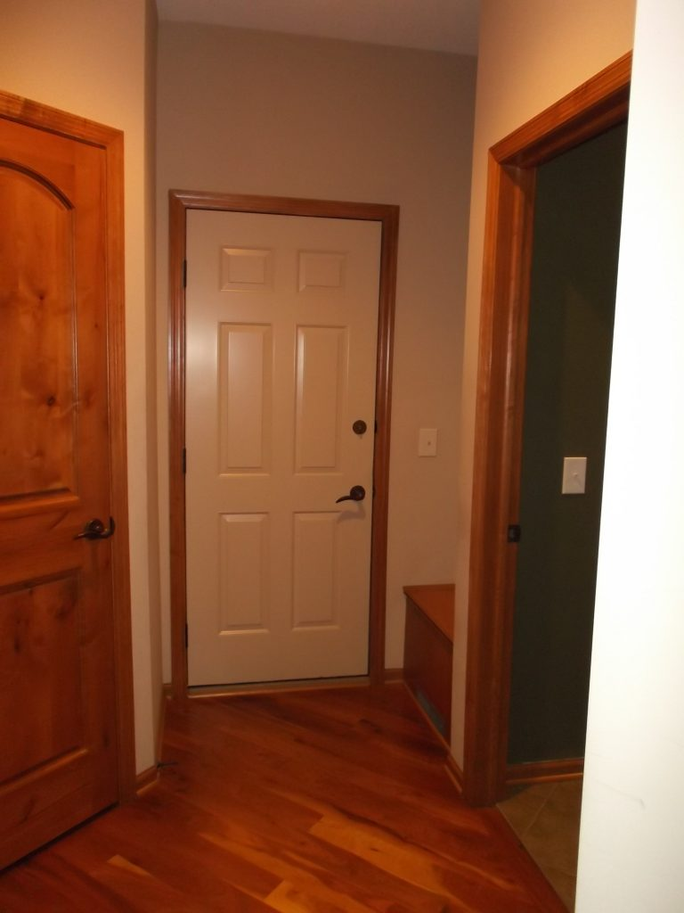 "The original ""mudroom"" consisted of a too-small bench right next to the back door and a closed-off closet that was difficult to access on a day-to-day basis."