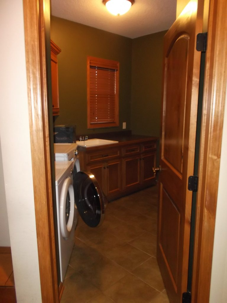 The original laundry room was dark and muted, which caused the room to feel cramped and small.