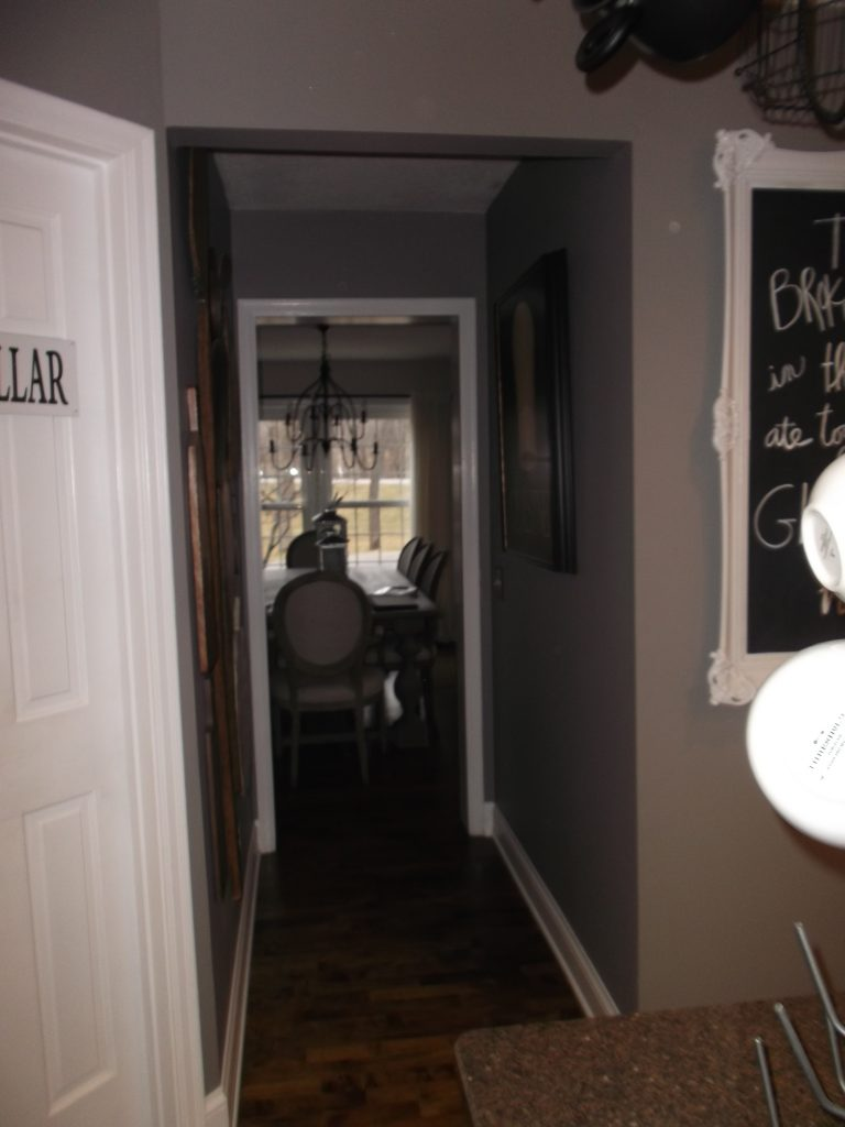 The adjoining dining room was only accessible via a narrow hallway due to the placement of the pantry in the original layout, and the load-bearing header was visible just above the doorway.