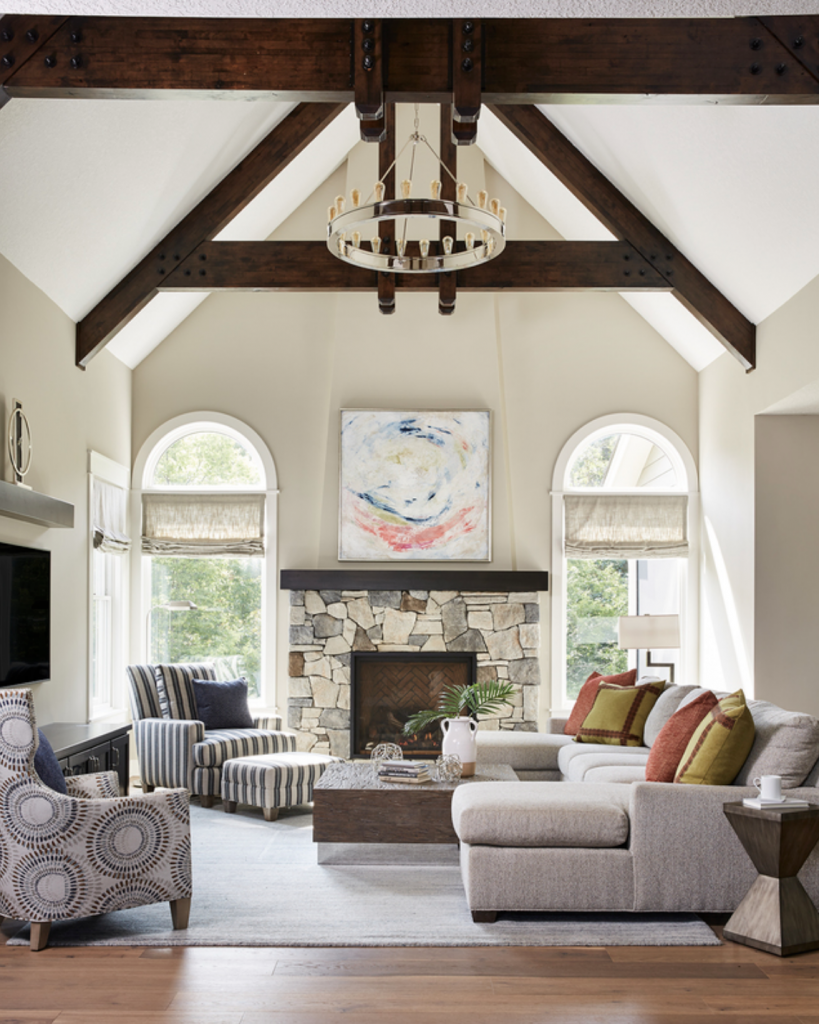 With a vaulted ceiling, exposed beams, plenty of natural light, and an open floor plan, Revere Pewter is the perfect paint shade to make everything in this space feel cohesive. (Interior Design: Carla Bast | Sneak Peek Design)