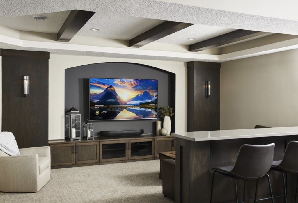 With pops of deep brown stain and charcoal as bold accents, this home theater gets an extra dose of elegance with a coat of Revere Pewter on its walls. (Interior Design: Carla Bast | Sneak Peek Design)