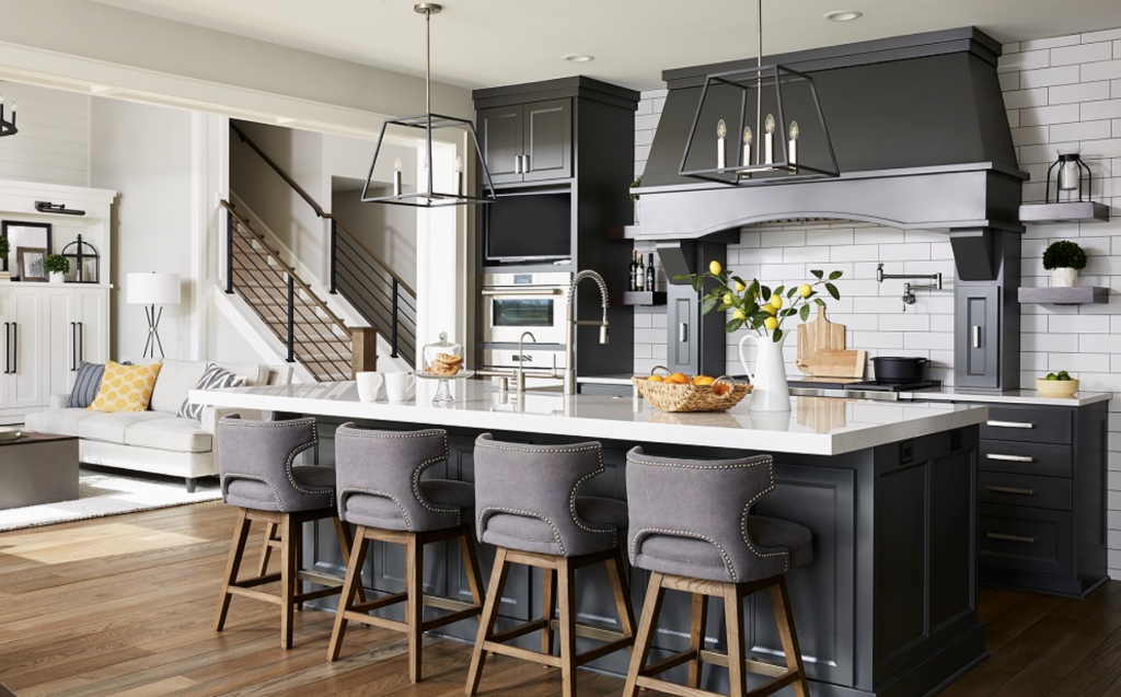 A mix of gray cabinetry, furniture, and fixtures pull out the gray undertones in the wall paint thanks to a coat of Benjamin Moore's Collingwood. (Interior Design: Carla Bast | Sneak Peek Design)