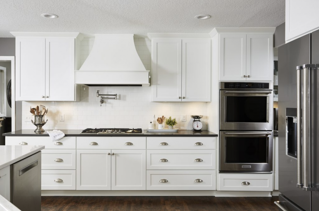 Creamy white cabinets offered a significant amount of storage options for the owners, along with ample countertop space for meal prep.