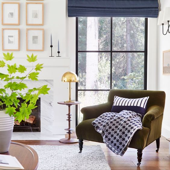Oftentimes, the best spaces for video calls are in a beautifully-decorated (and comfortable) corner of the home; this window backdrop in the living room is no exception and it's an ideal space to hold virtual meetings.