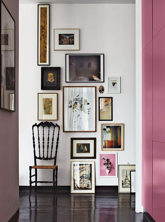 Colorful and eclectic, this gallery wall defies expectations by using the entirety of the wall's vertical space.