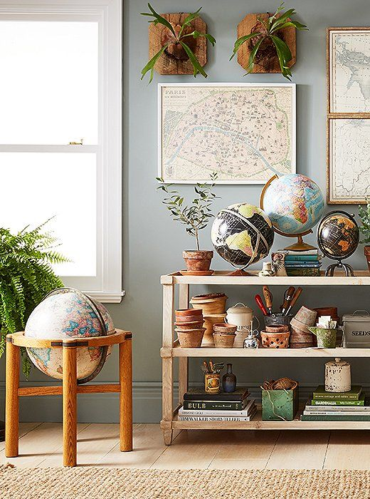 A collection of maps and globes creates an interesting and beautiful display in this office, doubling up as a video conference backdrop that awes.