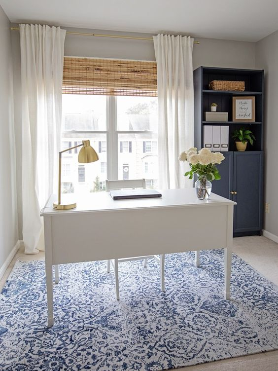 Simple and stylish, this blue and white home office uses the light of the off-center window as it's backdrop for everyday tasks.