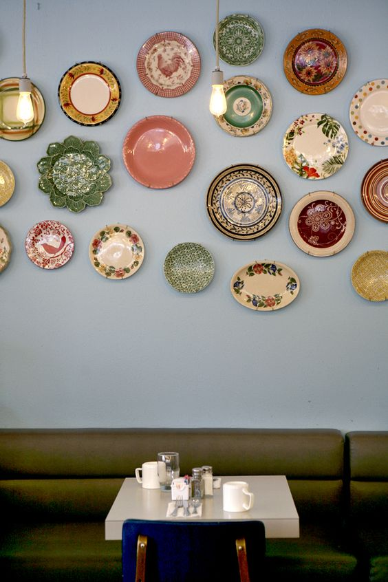 By mounting a collection of vintage and uniquely-patterned plates on the wall, it gives this space a completely personalized look, and the eclectic array makes for a beautiful video backdrop.
